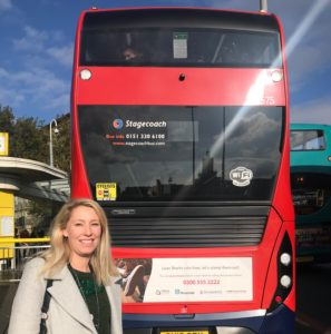 Riverside's Lorna Cotterill with the Stop Loan Sharks bus campaign.